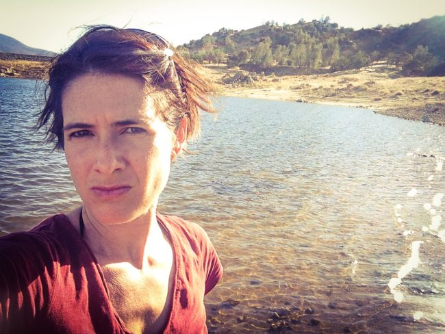 Woman grimaces at low water levels of Lake Isabella